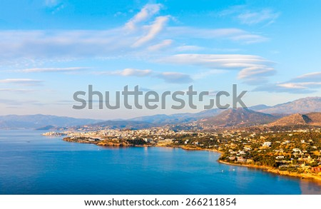 Panoramic view of the town of Agios Nikolaos and the Mirabello Bay. Crete, Greece. Agios Nikolaos is a picturesque town in the eastern part of the island Crete. - stock photo