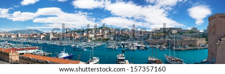 Panoramic view of the Vieux port of Marseille and Notre Dame de la Garde at back, France