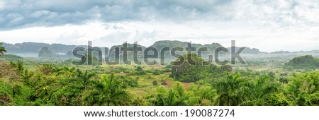 Panoramic view of the Vinales Valley, a cuban natural landmark famous for its beauty and its tobacco plantations - stock photo
