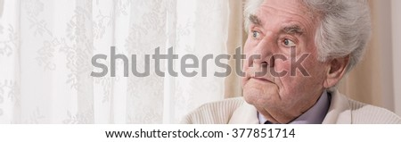 Panoramic view of thoughtful elderly man - head photoshoot