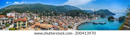 Panoramic view of traditional Greek houses, mountains, islands and Ionian Sea in Parga, Greece. - stock photo