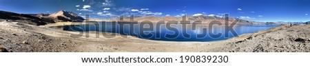 panoramic view of Tso Moriri lake, Korzok village and mounts Chamser Kangri and Lungser Kangri - Rupshu valley - Ladakh - India - The lake is at an altitude of 4 595 m  - stock photo
