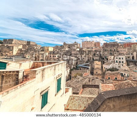 panoramic view of typical stones (Sassi di Matera) of Matera under blue sky. Matera in Italy UNESCO European Capital of Culture 2019