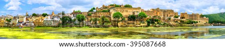 Panoramic view of Udaipur city with Maharajah Palace and lake Pichola, India - stock photo