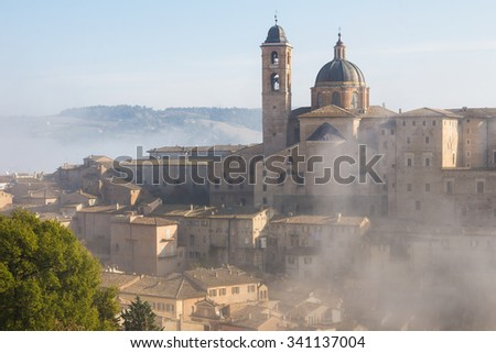 Panoramic view of Urbino with fog, Unesco site. Marche.     - stock photo