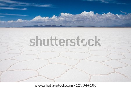 Panoramic view of Uyuni salt flats with white clouds, Bolivia - stock photo
