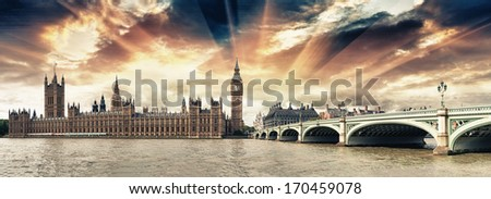 Panoramic view of Westminster Bridge and Houses of Parliament at sunset - London. - stock photo