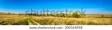 Panoramic view of wonderful autumnal  landscape and blue sky. - stock photo