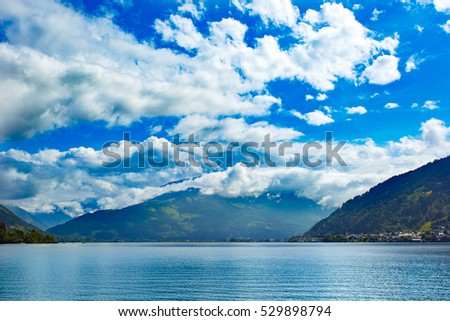 Panoramic view of Zeller See lake. Zell Am See, Austria, Europe. Beautiful clouds and Alps at background.
