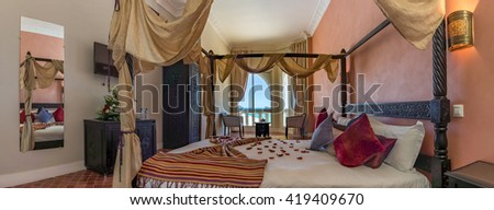 Panoramic view on a luxury bedroom with seaview - stock photo