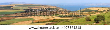 Panoramic view on agriculture valley Arbel.Green fields,arable lands,olive plantations, livestock farms and wheat harvesting fields.In the background Sea of Galilee -Tiberius lake.Low Galilee, Israel  - stock photo