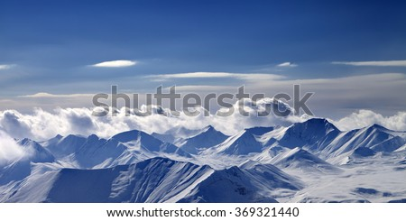 Panoramic view on cloudy mountains in evening. Caucasus Mountains, Georgia, region Gudauri. - stock photo