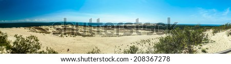 Panoramic view on dunes of the Curonian spit.The Curonian Spit is home to the highest drifting sand dunes in Europe. Nida, Lithuania - stock photo