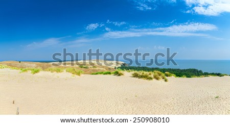 Panoramic view on dunes of the Curonian spit. This place to the highest drifting sand dunes in Europe. Nida, Lithuania. - stock photo