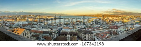 Panoramic view on Geneva city and lake by sunset from Saint-Pierre cathedral, Switzerland - stock photo