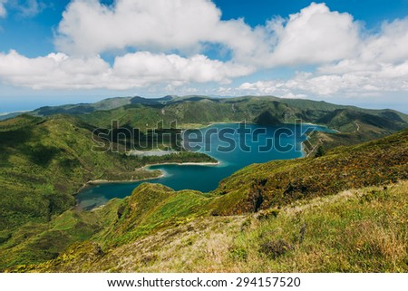 Panoramic view on Lagoa do Fogo, a crater lake within the Agua de Pau Massif stratovolcano in the center of the island of Sao Miguel in the Portuguese archipelago of the Azores.