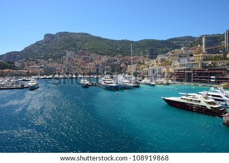 Panoramic view on marina with yachts and residential buildings in Monte Carlo, Monaco. - stock photo