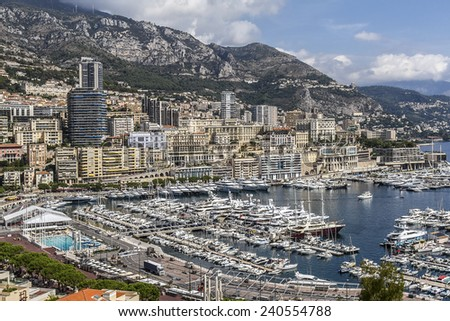 Panoramic view on marina with yachts and residential buildings in Monte Carlo, Monaco. Principality of Monaco is a sovereign city state, located on the French Riviera in Western Europe. - stock photo