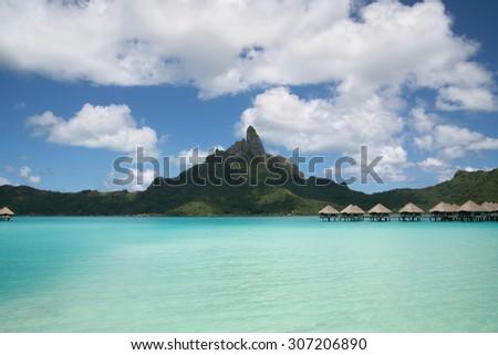 panoramic view on Mount Otemanu through turquoise lagoon on the tropical island Bora Bora, honeymoon destination, near Tahiti, French Polynesia, Pacific ocean - stock photo