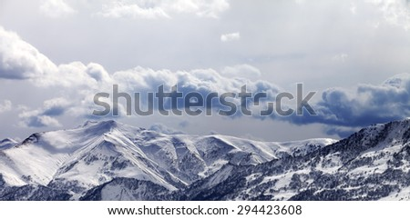 Panoramic view on mountains in evening and cloudy sky. Caucasus Mountains. Georgia, ski resort Gudauri. - stock photo