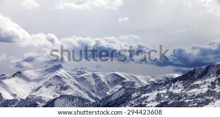 Panoramic view on mountains in evening and cloudy sky. Caucasus Mountains. Georgia, ski resort Gudauri. - stock photo