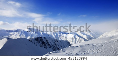Panoramic view on snowy mountains at sun day. Caucasus Mountains, Georgia, ski resort Gudauri.  - stock photo