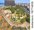 Panoramic view on Tel-Aviv park on the coast of the Mediterranean Sea (Israel) on the modern buildings background - stock photo
