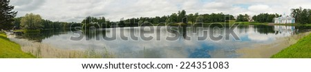 Panoramic view on the lake in Catherine Park of Tsarskoye Selo about the city of St. Petersburg, Russia.