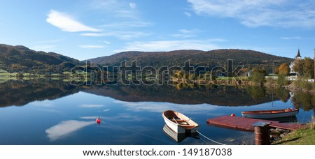 Panoramic view on the lake Oppheimsvatnet with moored boats, Opheim, Norway.