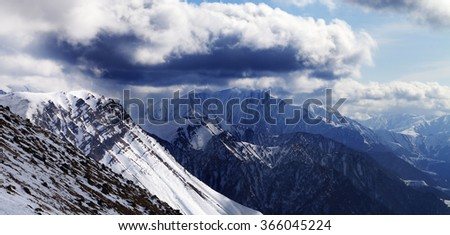 Panoramic view on winter mountains in evening and cloudy sky. Caucasus Mountains, Georgia, region Gudauri. - stock photo