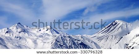 Panoramic view on winter snowy mountains in windy day. Caucasus Mountains, Georgia. Ski resort Gudauri. - stock photo