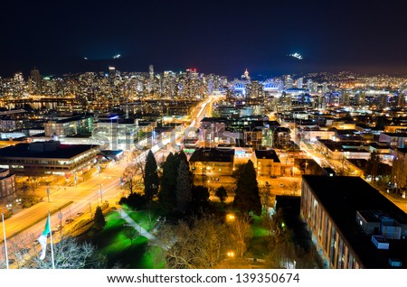 Panoramic view, outlook at downtown city of Vancouver at night, dawn time.  Colorful city night with skyscrapers, highrise buildings. - stock photo
