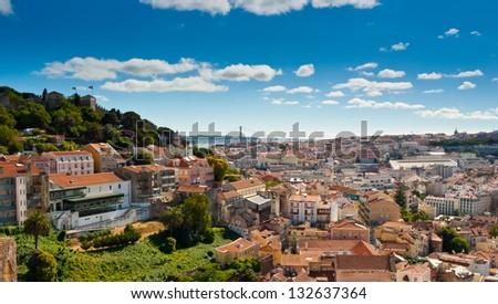 Panoramic view over Baixa and Castelo de Sao Jorge from Alfama, Lisbon, Portugal - stock photo