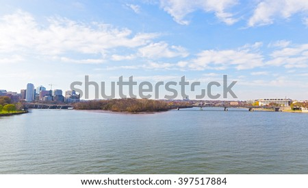 Panoramic view over Potomac river in Washington DC. Rosslyn skyline, the Key Bridge and Kennedy Center for the Performing Arts in spring. - stock photo