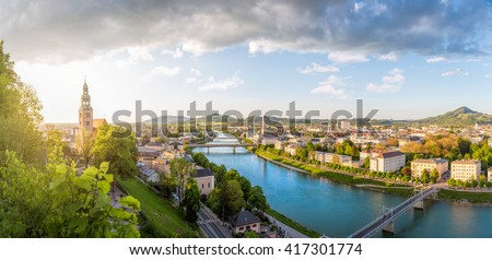 Panoramic view over Stadt Salzburg with Salzach river at evening, Salzburg, Austria - stock photo