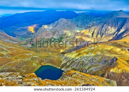 Panoramic view over the lake and mountains. Picture was taken during trekking hike in scenic and beautiful Caucasus mountains at autumn,Arhiz region, Abishira-Ahuba range, Karachay-Cherkessia, Russia - stock photo