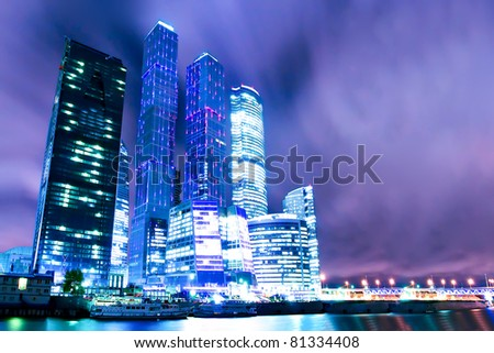 panoramic view to cityscape of business illuminated skyscrapers at night