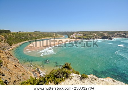 Panoramic view to Praia de Odeceixe, Surfer beach on the West coast of Algarve, District Aljezur Portugal - stock photo