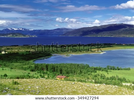 Panoramic view to river with farmland and mountains, Norway - stock photo