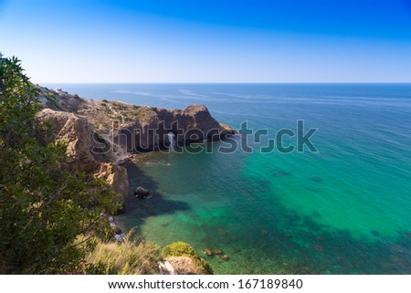 panoramic view to rocky sea coastline with mountains cliffs - stock photo