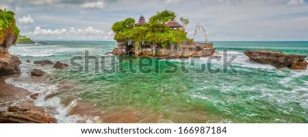 Panoramic view to Tanah Lot temple famous touristic landmark to visit at Bali, Indonesia - stock photo