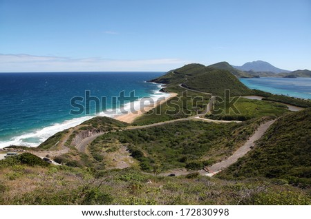 Panoramic view to the eastern part of Saint Kitts island and to Nevis island from Timothy Hill - stock photo