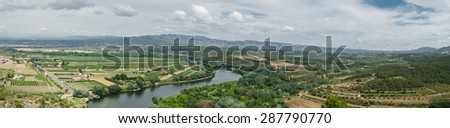 Panoramic view to the Ebro River passing through castle Miravet, Spain. - stock photo