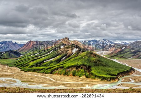 Panoramic view to vibrant colour iceland mountains in summer - stock photo