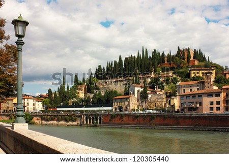 Panoramic view toward Castel San Pietro from the bank of the river Adige in Verona, Italy. - stock photo