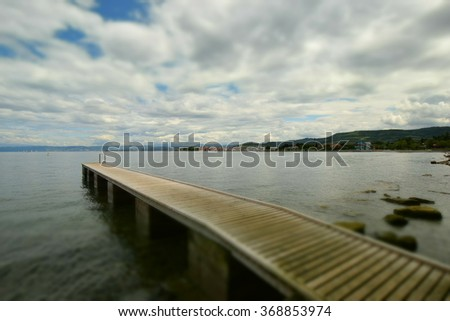 Panoramic view, wooden pier, sea and clouds