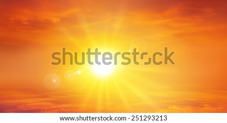 Panoramic warm sunset. High resolution sky background with a radiant setting sun