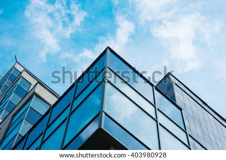 Panoramic wide angle view to steel blue background of glass high rise building skyscrapers in modern futuristic downtown - stock photo