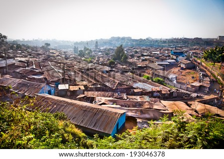 Panoriamic view of Kibera slums in Nairobi, Kenya. The largest slum of Africa is in Nairobi. About 270 thousand people living in Kibera. - stock photo