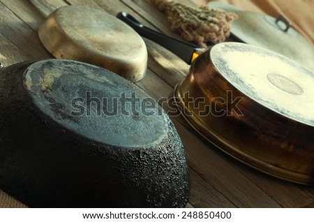 pans lie on a wooden table - stock photo